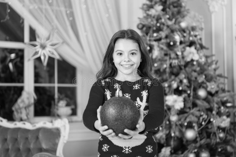 Happy new year. Christmas. Kid enjoy holiday. small happy girl at christmas. morning before Xmas. New year holiday. Little child girl likes xmas present stock photography