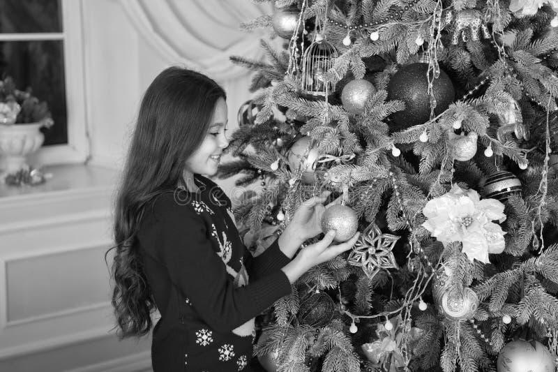 Happy new year. Christmas. Kid enjoy the holiday. small happy girl at christmas. The morning before Xmas. New year. Holiday. little child girl likes xmas stock photo