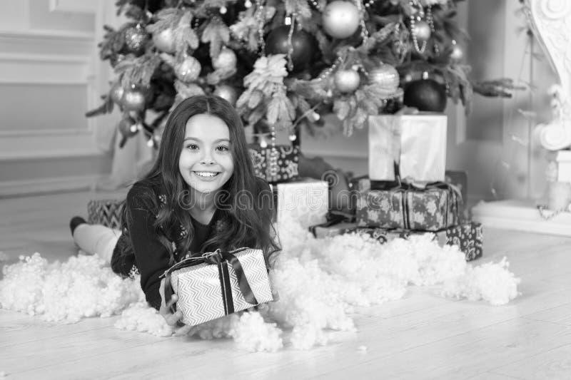 Happy new year. Christmas. Kid enjoy the holiday. small happy girl at christmas. The morning before Xmas. New year. Holiday. little child girl likes xmas royalty free stock photography