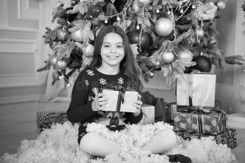 Happy new year. Christmas. Kid enjoy the holiday. small happy girl at christmas. The morning before Xmas. New year. Holiday. little child girl likes xmas royalty free stock image