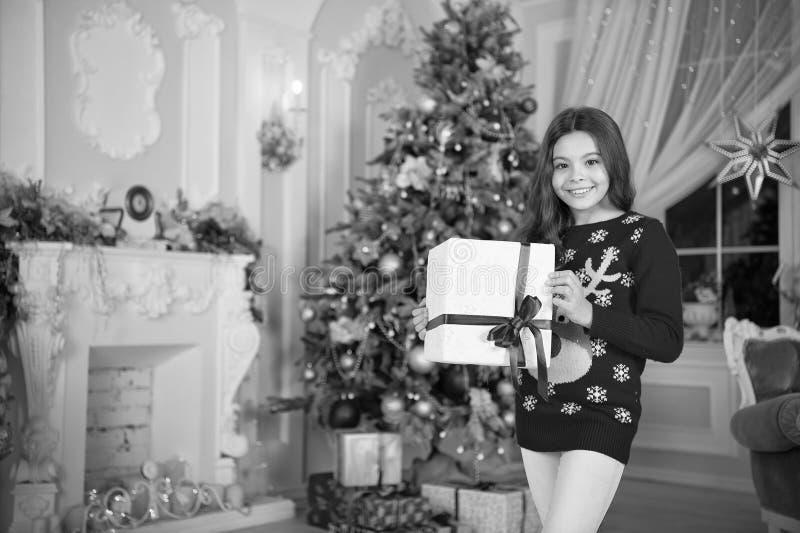 Happy new year. Christmas. Kid enjoy the holiday. small happy girl at christmas. The morning before Xmas. New year. Holiday. little child girl likes xmas royalty free stock photo