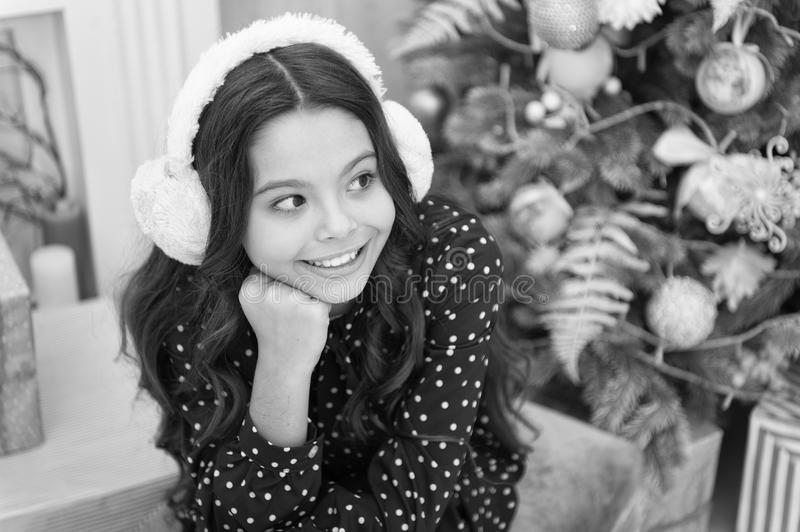 Happy new year. Christmas. Kid enjoy the holiday. small happy girl at christmas. The morning before Xmas. warm earphones. New year holiday. little child girl royalty free stock image