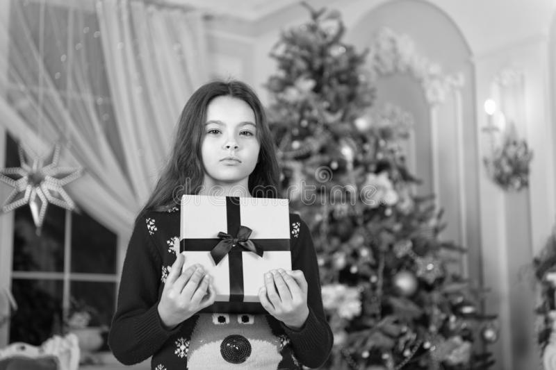 Happy new year. Christmas. Kid enjoy the holiday. small serious girl at christmas. The morning before Xmas. New year. Holiday. little child girl likes xmas stock images