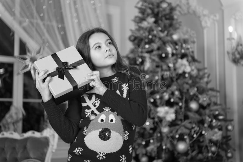 Happy new year. Christmas. Kid enjoy the holiday. small thoughtful girl at christmas. The morning before Xmas. New year. Holiday. little child girl likes xmas royalty free stock photo