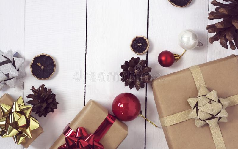 Happy new Year 2020 christmastime. Gift boxes and christmas tree toys on background. Winter light rustic photo stock images