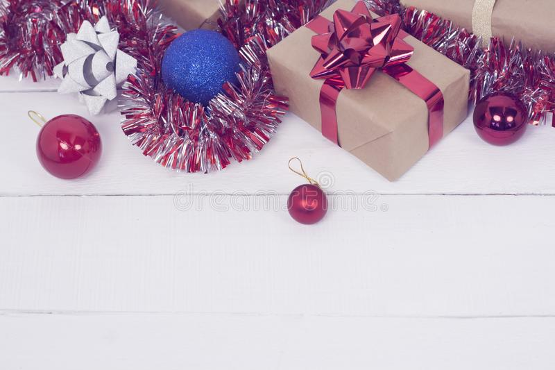 Happy new Year 2020 christmastime. Gift boxes and christmas tree toys on background. Winter light rustic photo stock photos