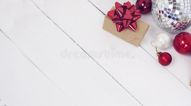 Happy new Year 2020 christmastime. Gift boxes and christmas tree toys on background. Winter light rustic photo stock photography