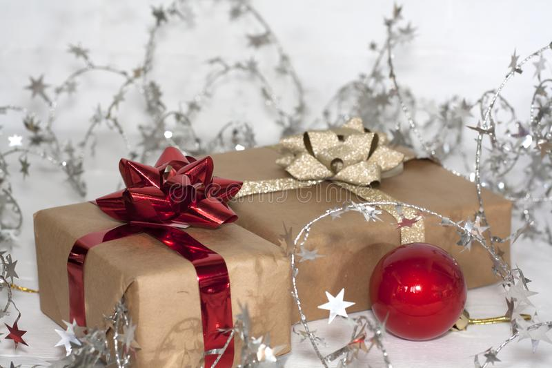 Happy new Year 2020 christmastime. Gift boxes and christmas tree toys on background. Winter light rustic photo royalty free stock photo