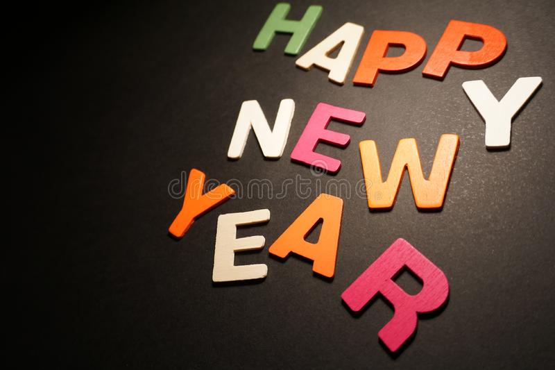 Happy New Year. Color letters on black background text message creative illustration graphic design pedryj royalty free stock image