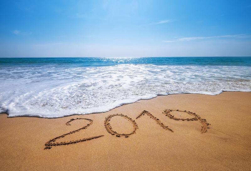 Happy New Year 2019 is coming concept sandy tropical ocean beach royalty free stock image