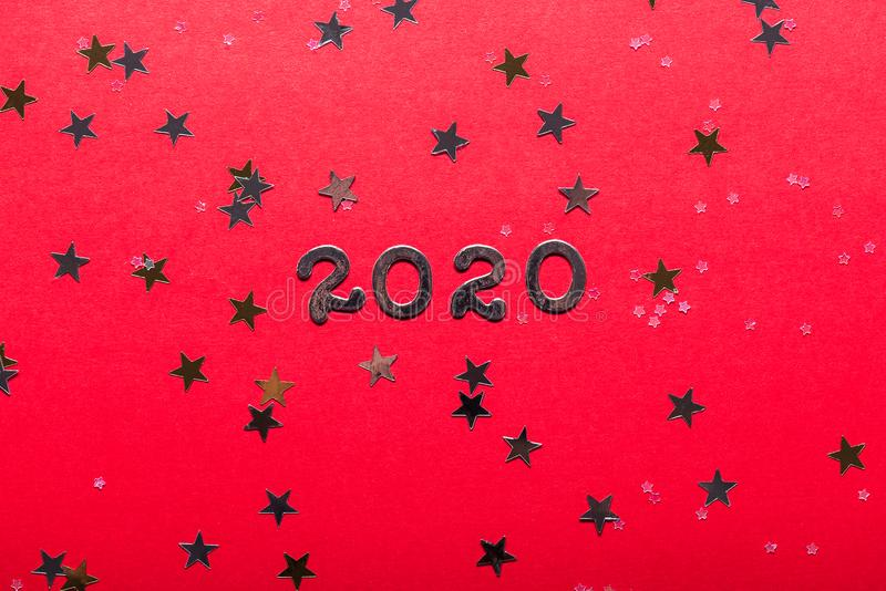 Happy New Year 2020 concept. On bright red background stock photo