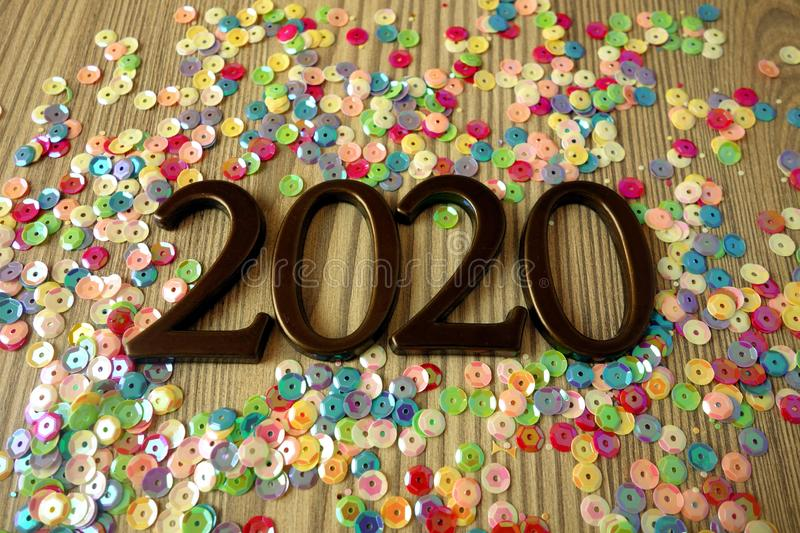 Happy New Year 2020 concept with digits and ornaments. On wooden table stock photos