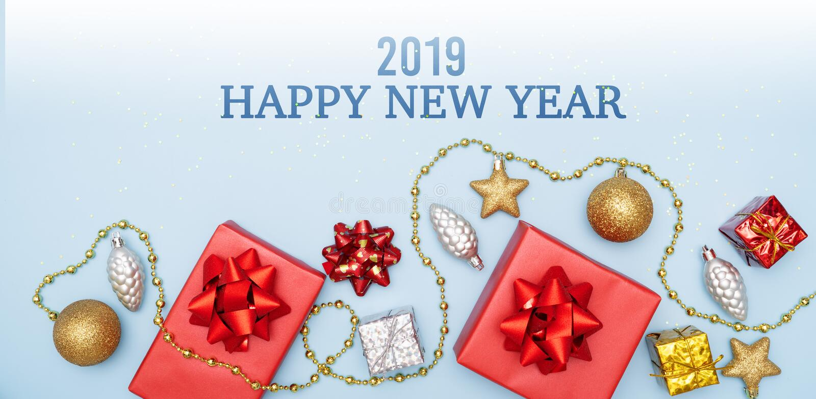 2019 Happy New Year concept, gifts boxes or presents boxes with red bows, star and ball on blue background royalty free stock photos