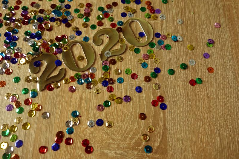 Happy New Year 2020 concept with golden digits and colorful shiny ornaments stock photography