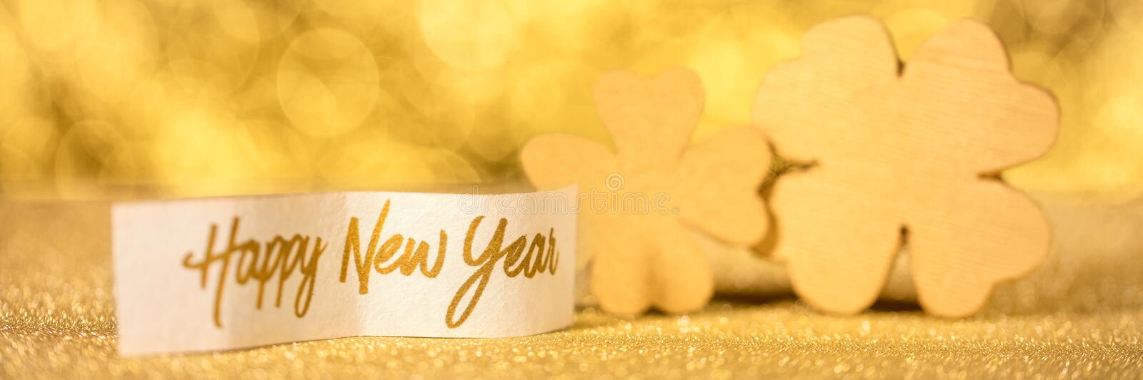 Happy new year. Concept happy new year, golden shamrocks with text stock image