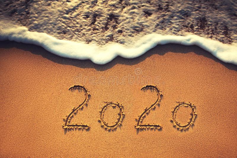 Happy New Year 2020 concept on the sea beach; sunrsie shot. Happy New Year 2020 concept, lettering on the beach. Sea sunrise royalty free stock photography