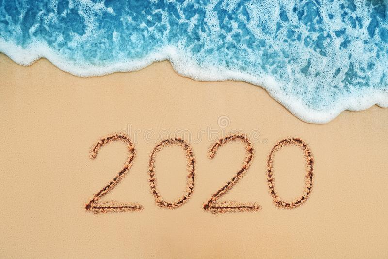 Happy New Year 2020 concept on the sea beach; sunrsie shot. Happy New Year 2020 concept, lettering on the beach. Sea sunrise royalty free stock images