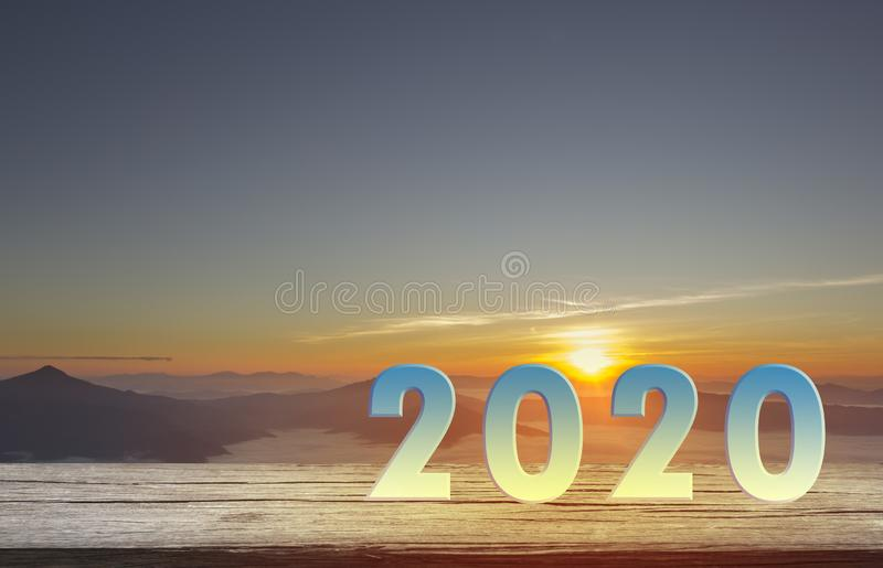 Happy New Year 2020 concept with text 2020 put on wood royalty free stock image