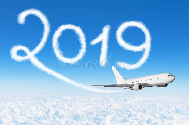 Happy New year 2019 concept travel. Drawing by passenger airplane vapor contrail in sky.  stock image