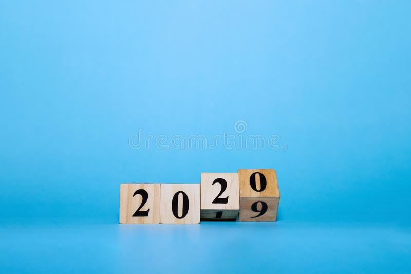 Happy New year concept. Wooden block cube of 2020 year number on blue isolate background royalty free stock photos
