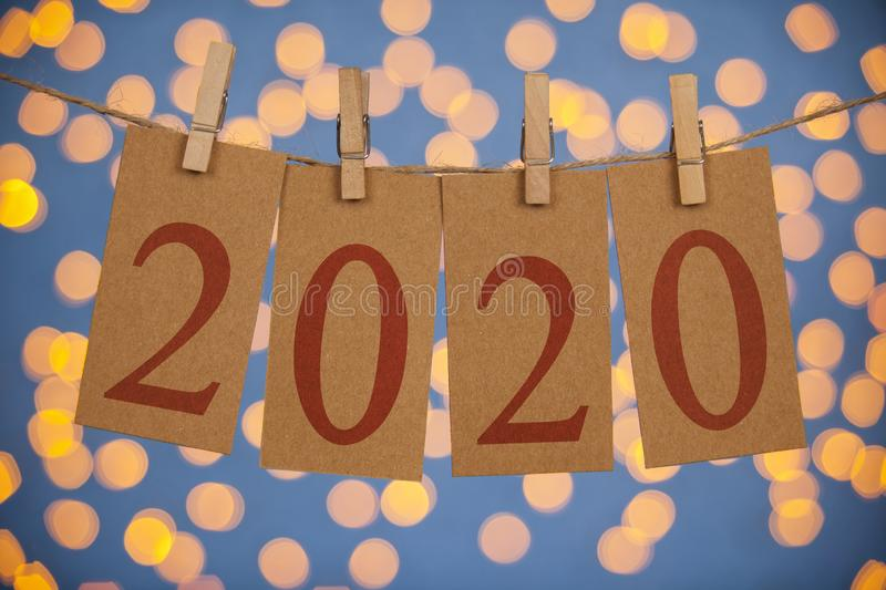 Happy New Year 2020 Concepts Clipped Cards and Lights. Silhouette young woman happy for 2020 new year new year concepts royalty free stock photos