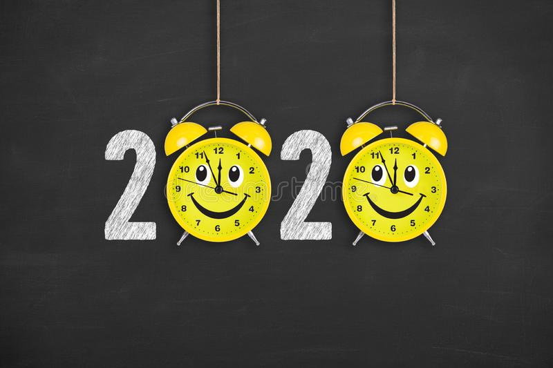 Happy new year concepts 2020 countdown clock over human head on chalkboard background. New year concepts stock images