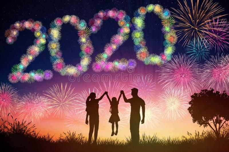 New year 2020 concepts. family watching fireworks  on hill. Happy new year 2020 concepts. family watching fireworks  on hill royalty free stock images