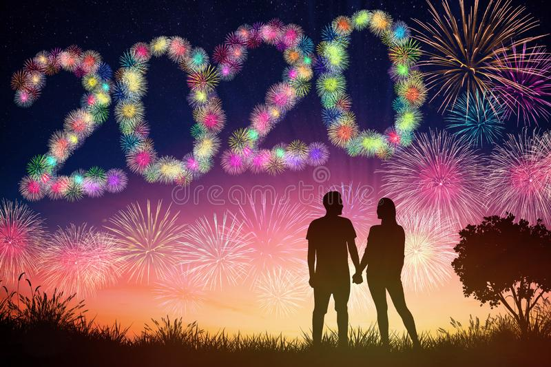 New year 2020 concepts. young couple watching fireworks  on hill. Happy new year 2020 concepts. young couple watching fireworks  on hill stock photo