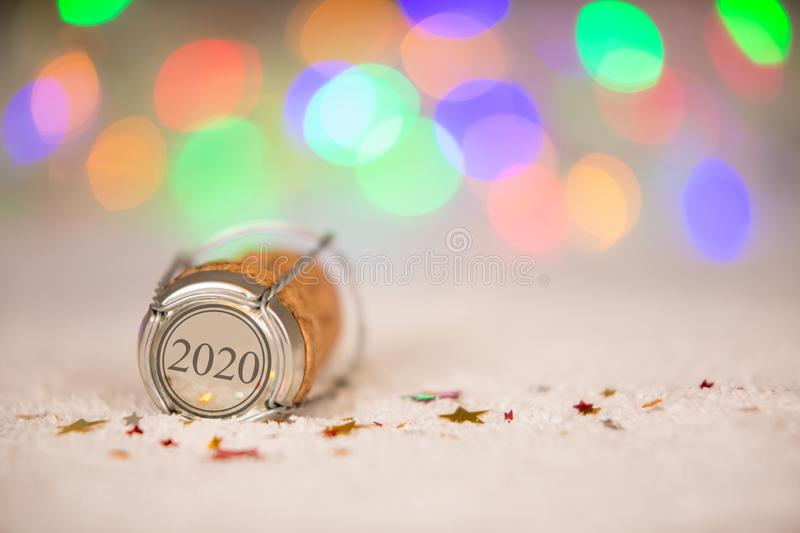 Happy New Year 2020 with Cork on the Snow. New year concepts royalty free stock photo