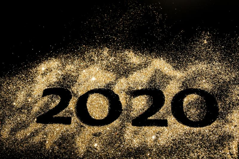 Happy New Year 2020. Creative Collage of numbers two and zero made up the year 2020. Beautiful sparkling Golden number 2020 on royalty free stock photo