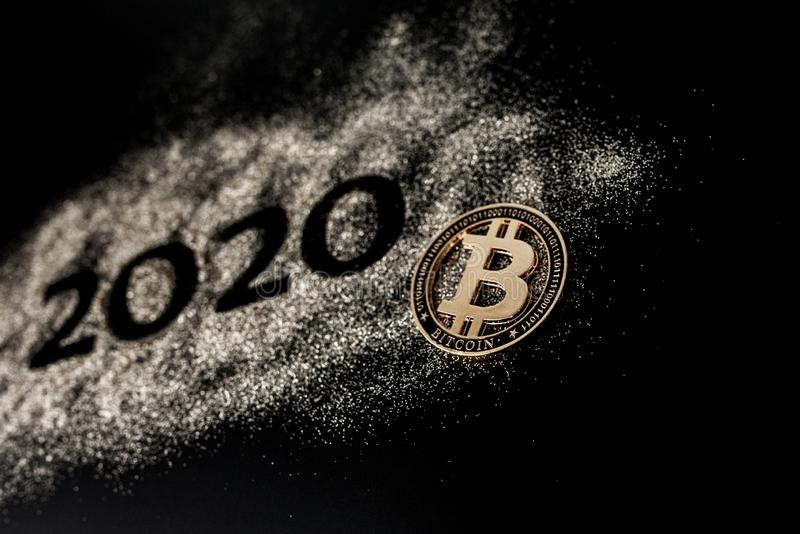 Happy New Year 2020 . Creative Collage of numbers two and zero made up the year 2020. Beautiful sparkling Golden number 2020 and. Bitcoin on black background stock photos