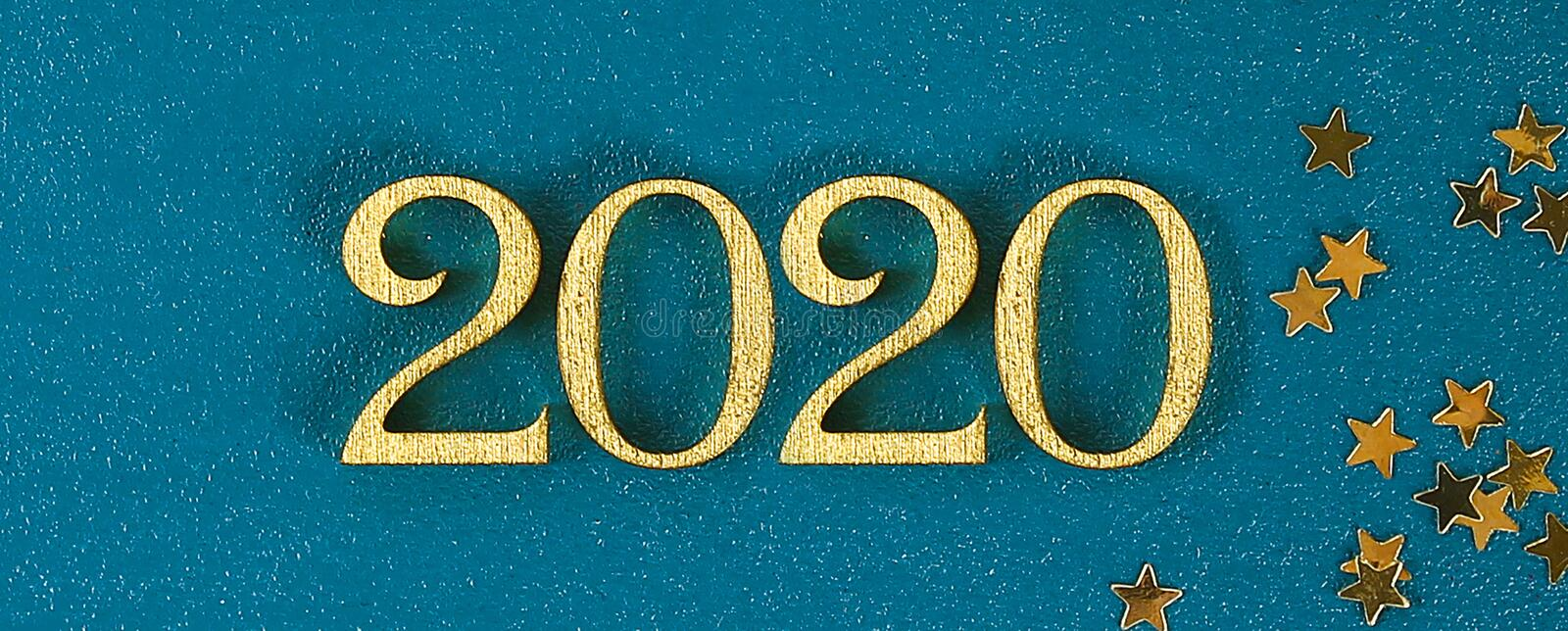 Happy New Year 2020. Creative text Happy New Year 2020 written in gold wooden letters. Banner stock photos