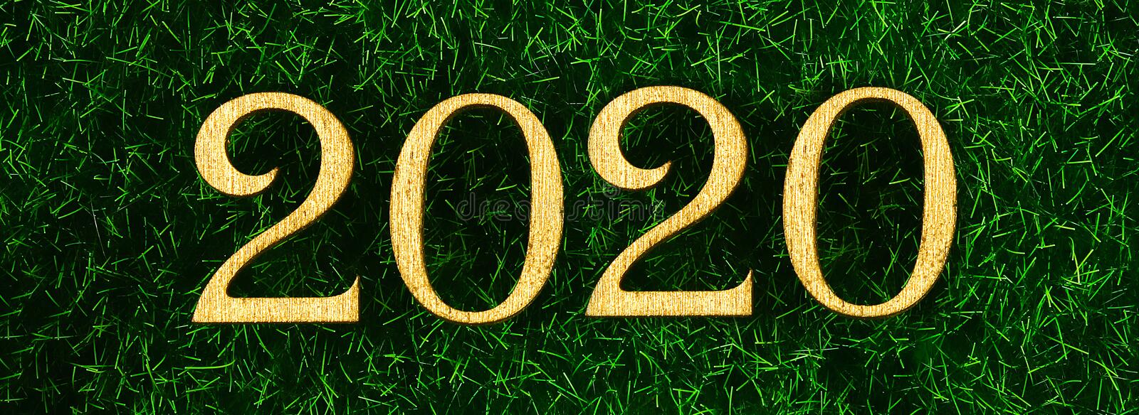 Happy New Year 2020. Creative text Happy New Year 2020 written in gold wooden letters. Banner royalty free stock photos