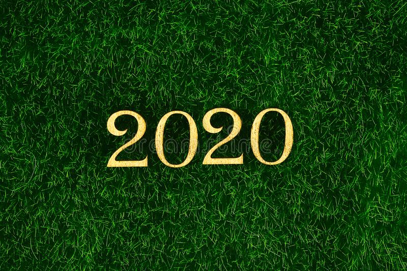 Happy New Year 2020. Creative text Happy New Year 2020 written in gold wooden letters. Merry christmas. Xmas stock images