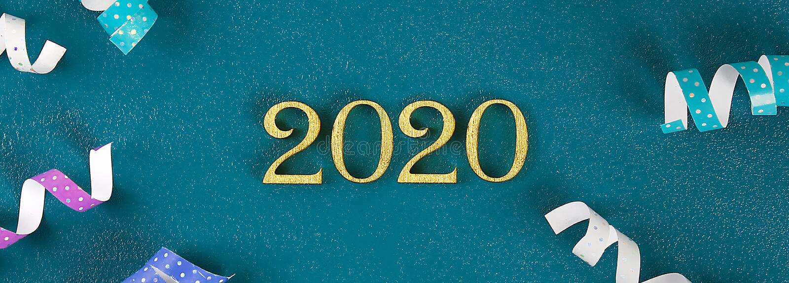 Happy New Year 2020. Creative text Happy New Year 2020 written in gold wooden letters. Banner stock images