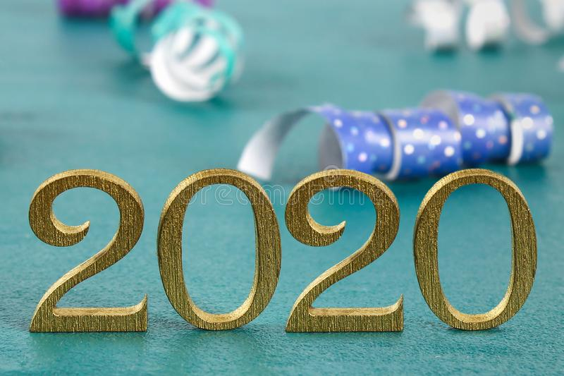Happy New Year 2020. Creative text Happy New Year 2020 written in gold wooden letters royalty free stock photo