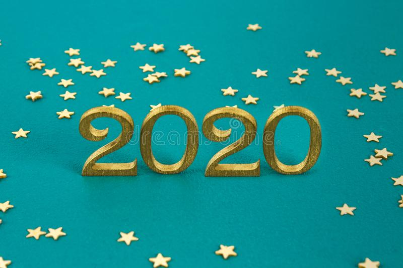 Happy New Year 2020. Creative text Happy New Year 2020 written in gold wooden letters. Merry christmas. Xmas stock photos