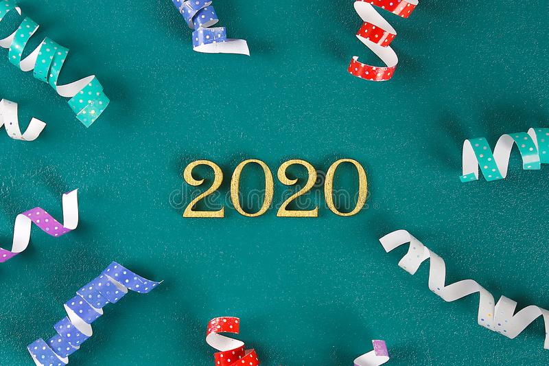 Happy New Year 2020. Creative text Happy New Year 2020 written in gold wooden letters. Merry christmas. Xmas royalty free stock image