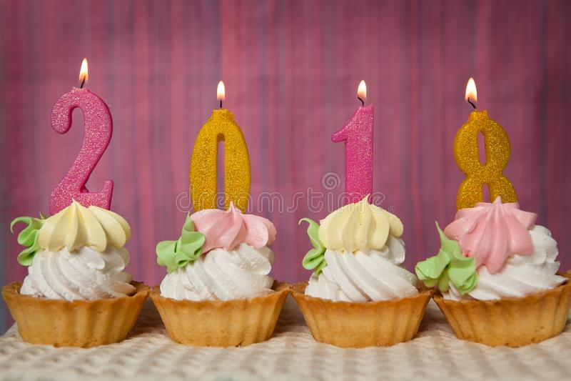 Happy new 2018 year, cupcakes with number candles royalty free stock image
