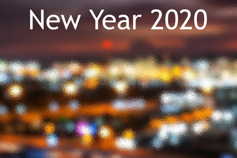 Happy New Year 2020 With Dark Navy Blue Glitter Bokeh Light Sparkling Background,holiday Celebration royalty free stock image