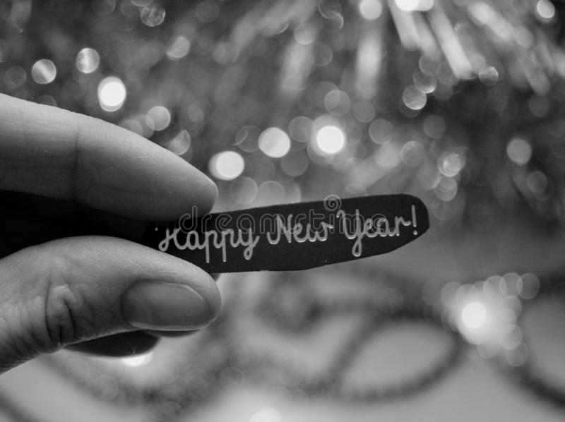 Happy New year in hand decor black and white background royalty free stock image