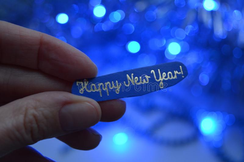 Happy New year in hand decor blue background royalty free stock photo