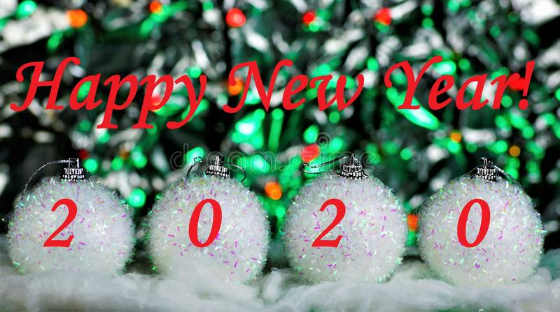 Happy new year 2020-decoration toys-white sparkling balls, elegant snow-covered fir branch, festive bokeh background for creative royalty free stock photography