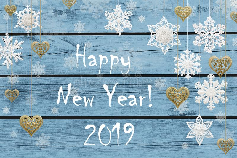 Happy New Year! New Year decorations: snowflakes and golden hearts stock photos
