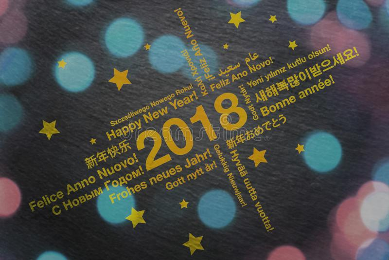 Happy New Year in different languages greeting card concept stock photo