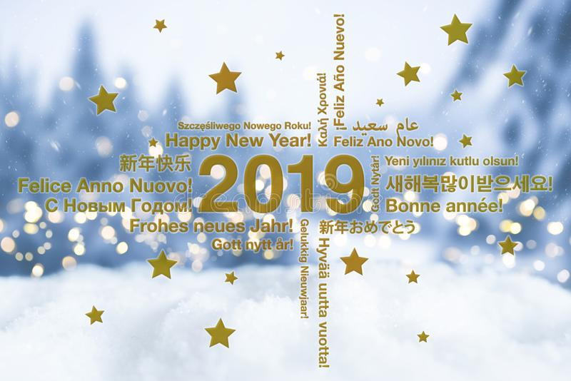 Happy New Year in different languages greeting card with snowy winter landscape in blured background royalty free stock images
