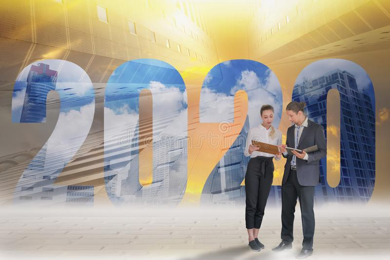 Happy New Year 2020 Digital Trend Concept,businessman and businesswoman stand to discuss company plans,goals and future planning. New marketing trending,with royalty free stock photos