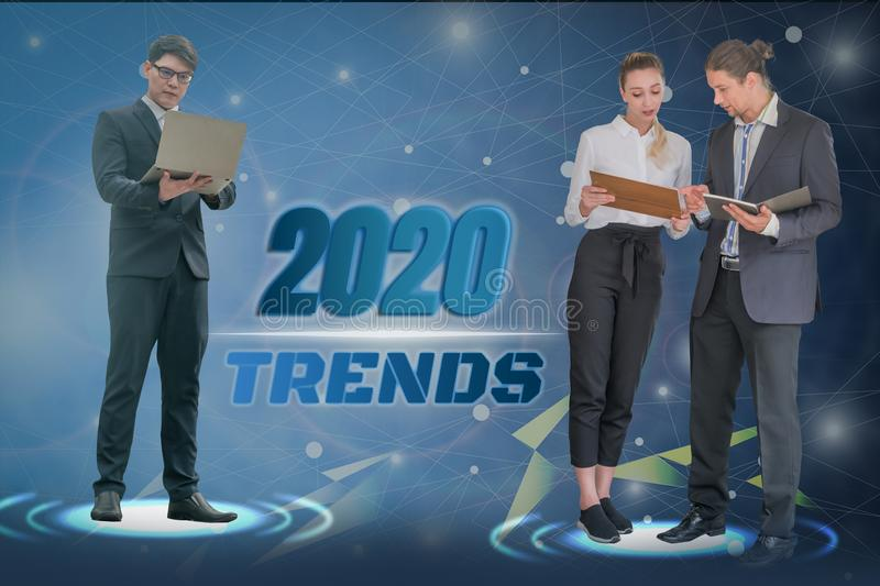 Happy new year 2020 digital trends concept,with business group successful business team work,with futuristic abstract illuminate stock image