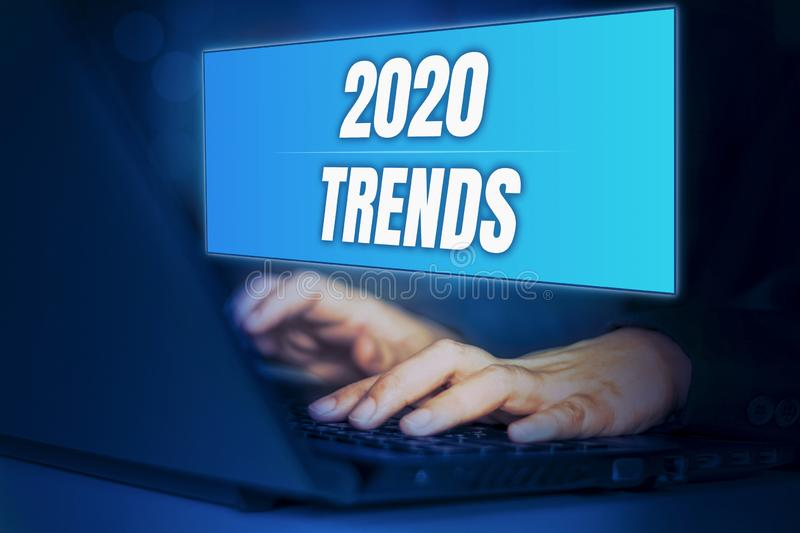 Happy new year 2020 digital trends concept,with businesswoman typing keyboard search information  business trendy for work,with. Blue screen hologram and dark stock photo