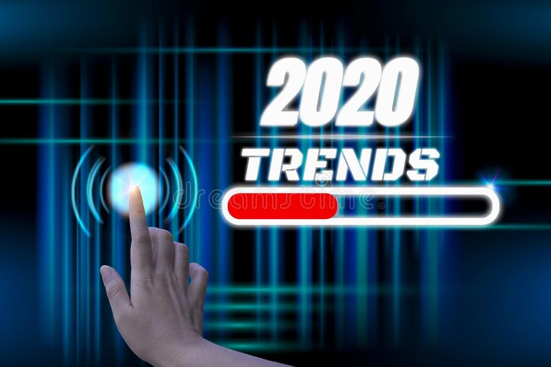 Happy new year 2020 digital trends concept,with hand touch futuristic button hologram,with abstract line illuminate connection,. And bright blue black stock photography